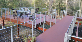 Elevated Deck with Cable Rail System. For Your Deck, Porch and Patio Needs Call DCI Home Works: 1-800-254-3643