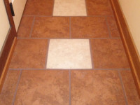 Add Beauty and Durability with a New Tile or Wood Floor Installed by DCI Home Works - Call 1-800-254-3643 for an Estimate